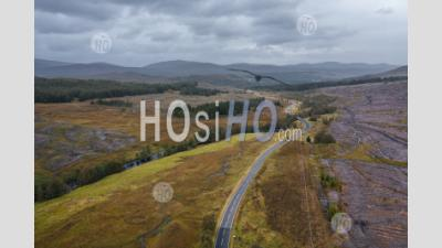 Empty Road In The Northwest Highlands Of Scotland At Autumn - Aerial Photography