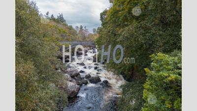 Stone Bridge Over Little Gruinard River In The Northwest Highlands Of Scotland - Aerial Photography
