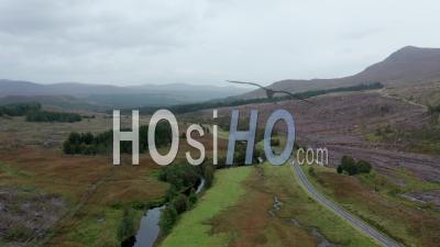 Scenic Road In The Northwest Highlands Of Scotland At Autumn - Video Drone Footage