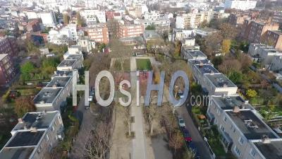 From Park To Building At Le Pre Saint Gervais Suburb Of Paris, Backward, Video Drone Footage