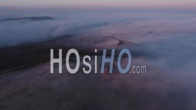 Mont Saint Michel De Braspart At Frozen Sunrise, Clouds And Sun. - Drone Point Of View