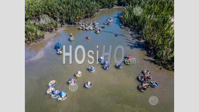 Top View With Drone Of Coconut Tree Forest With Bamboo Basket Boats In Hoi An,Vietnam - Aerial Photography