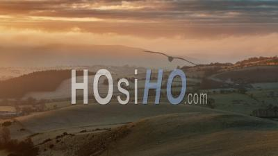 Rolling Hills Of British Countryside At Frosty Sunrise