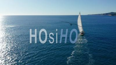 Sailing Boat Along The Calanques Of Marseille, Blue Coast Area - Drone Point Of View
