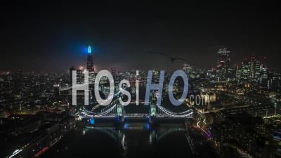 Aerial Bird-Eye View Shot Of London Skyline, New Year Celebrations Fireworks, Tower Bridge, United Kingdom - Drone Stock Footage
