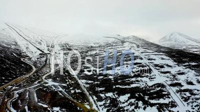Cairngorm Mountains In Snow And Low Cloud, Aviemore, Scotland, Drone Point Of View