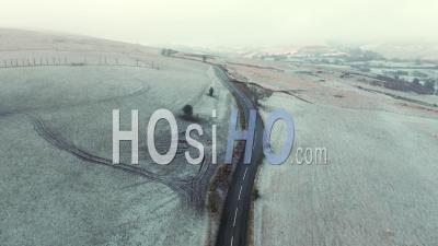 Rural Road Across Frosty Fields Of Shropshire - Video Drone Footage