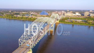 Memphis Tennessee Across The Mississippi River With Hernando De Soto Bridge Foreground And Memphis Pyramid Background - Aerial Video By Drone