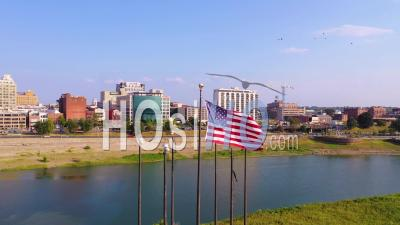 Flagpole And American Flag With Mississippi River Riverboats And City Of Memphis Downtown Business District Skyline Background - Aerial Video By Drone