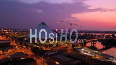 The Memphis Pyramid, Hernando De Soto Bridge And Cityscape At Dusk - Aerial Video By Drone