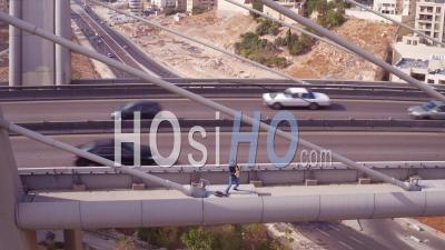 2019 - A Man Playing Saxophone On The Abdoun Bridge In Amman, Jordan - Aerial Video By Drone