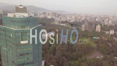 Foggy Aerial Past Office Building Skyscraper In Downtown Business District In Tblisi, Republic Of Georgia - Video Drone Footage