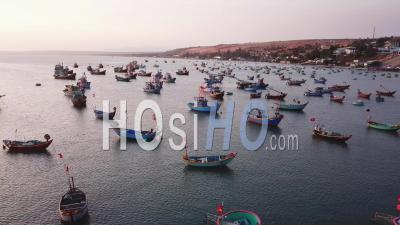 Fisherman Boats Parked In Bay During Sunset - Aerial Video By Drone