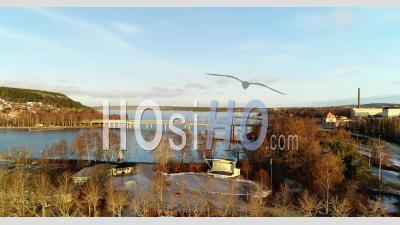 Panorama Over A Recreation Park At A Frozen Lake In The Morning Sun - Video Drone Footage