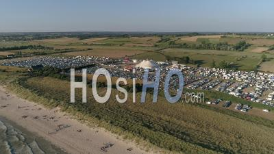 Music Festival At Seaside In Montmartin-Sur-Mer, Normandy, France - Drone Stock Footage