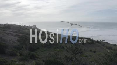 Nazare's Lighthouse On A Misty Morning - Video Drone Footage