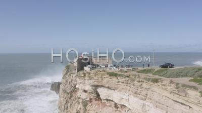 Breaking Wave In Front Of Nazare Lighthouse - Video Drone Footage