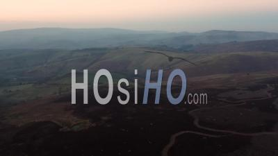 Scenic Moorland In Hazy Winter Sunset Light - Video Drone Footage