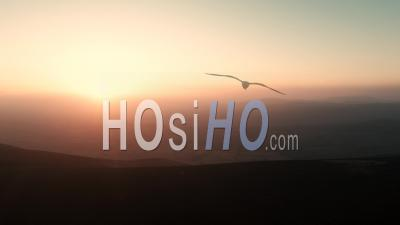 Warm Hazy Sunset Over Scenic Hills Of Shropshire At Winter - Video Drone Footage