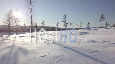 Snowy Forest And Snowmobile Tracks, Sunny Light And Blue Sky, Tackasen, Sweden - Video Drone Footage