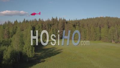 Helicopter Flying Above A Fir Trees Forest, Tackasen, Sweden - Video Drone Footage