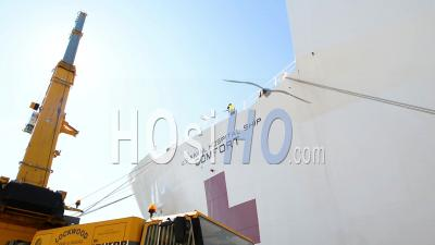 2020 - U.S. Navy Hospital Ship Mercy Is Loaded Dockside With Goods To Fight The Coronavirus Covid-19 Virus Outbreak.