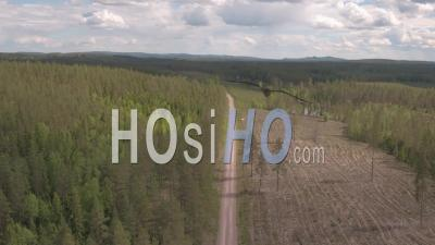 Cars Driving On A Track In The Middlle Of A Fir Trees Forest, Tackasen, Sweden - Video Drone Footage
