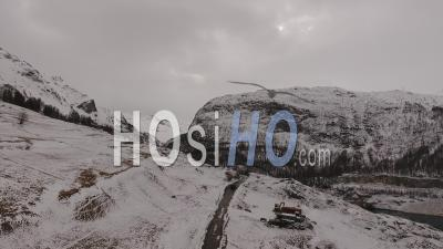 Car Driving On A Road In The Alps Mountains, Tignes, France - Video Drone Footage