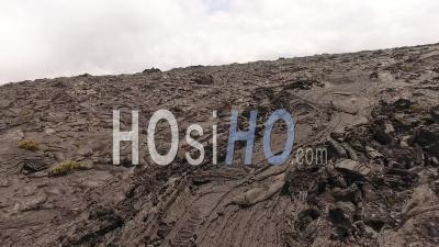 Aerial View Of Dark Volcanic Land, Mauna Loa Volcano, Hawaii - Video Drone Footage