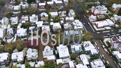 Aerial Tilt Up Over Snowy Winter Neighborhood, Houses, Suburbs In Snow In Portland, Oregon. - Video Drone Footage