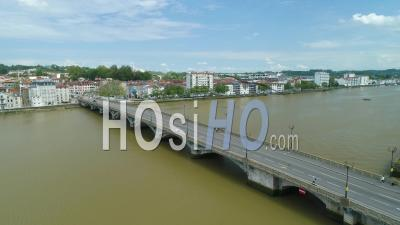 View On Bayonne Pont Rouge Bridge And People Walking During Covid-19 Lockdown, France - Video Drone Footage
