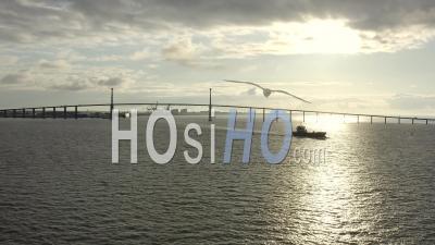 Saint Nazaire Bridge And Big Boat At Sunrise In Loire Atlantique France - Video Drone Footage