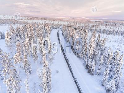 Dangerous, Icy Winter Roads In Bad, Slippery, Ice And Snow Covered Driving Conditions In Beautiful Road Trip Scenery Landscape - Aerial Photography