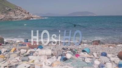 Environmental Impact Of Beach Covered In Plastic And Rubbish In Hong Kong. Aerial Drone View