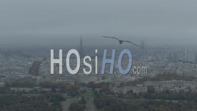 Aerial Footage Of Paris And Eiffel Tower Under A Cloudy Sky, Raw, Seen From Helicopter