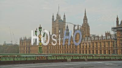 London In Coronavirus Covid-19 Lockdown With Empty Roads And Streets With No Cars Or Traffic And No People At Westminster Bridge With Houses Of Parliament In England, Uk At Rush Hour