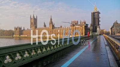 London In Coronavirus Covid-19 Lockdown With Empty Quiet Deserted Streets With No People And No Cars Or Traffic At Rush Hour At Westminster Bridge With Houses Of Parliament And Big Ben In England, Uk