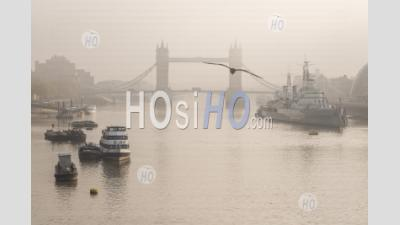 Tower Bridge With Red London Bus Driving Over It In London In Foggy Misty Weather, With The River Thames In Beautiful Mysterious Atmospheric Light, Shot In Coronavirus Covid-19 Lockdown In England, Europe