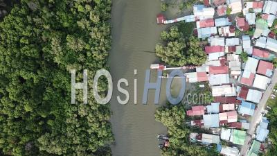 Aerial View River Separate The Mangrove Forest And Malays Housing Village. - Video Drone Footage