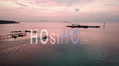 A Boat Leaving Fishing Jetty At Jelutong - Video Drone Footage