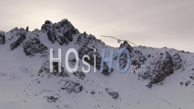 Aerial Footage Of Saulire Summit Near Courchevel Ski Resort And Deserted Ski Slopes While Covid-19 Lockdown, Filmed By Drone, Savoie, France