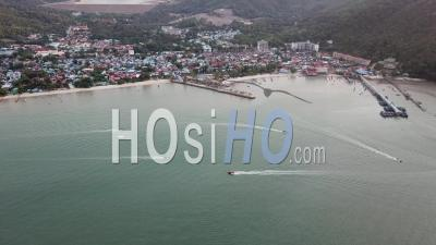 Boats Sail At Teluk Bahang Coastal - Video Drone Footage