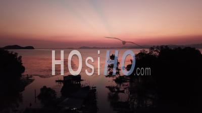 Aerial View Silhouette At Fishing Village - Video Drone Footage