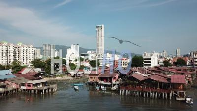 Aerial View Fly Towards Wooden Bridge At Seashore At Georgetown Penang - Video Drone Footage