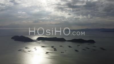 Aerial Tilt Down Pulau Aman Island With Background Penang Second Bridge - Video Drone Footage