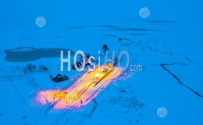 Night Aerial View Of Corrour Railway Station In Winter The Highest In The Uk On Rannoch Moor, Scottish Highlands, Scotland, Uk - Aerial Photography