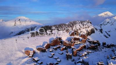 Aerial View Of Avoriaz 1800 (ski Resort) In Haute Savoie, France, Filmed By Drone In Winter Evening, Between Resort, Mountain And Cliff