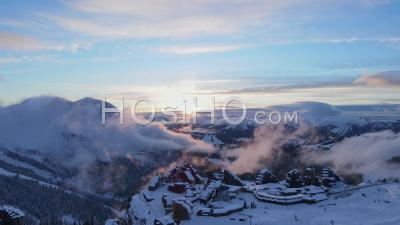 Aerial View Of Avoriaz 1800 (ski Resort) In Haute Savoie, France, Filmed By Drone In Winter Sunset, Between Resort, Mountain And Cliff, Auvergne Rhone-Alpes