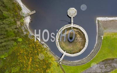Looking Down On Circular Spillway At Whiteadder Reservoir , East Lothian, Scotland Uk - Aerial Photography