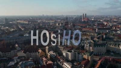 Beautiful City View Over Munich, Germany With Almost No Traffic At Isa Tor, Old City Gate And Frauenkirche Cathedral In Distance, Aerial View Above Munich In Autumn - Video Drone Footage